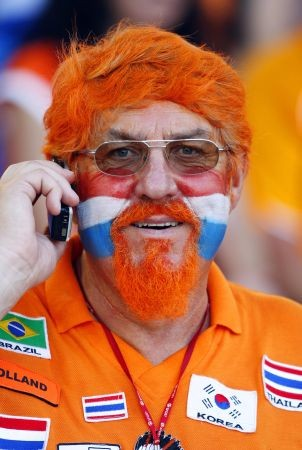 A Dutch supporter talks on his mobile prior to the kick off of the Euro 2008 Championships quarter-final football match the Netherlands vs. Russia on June 21, 2008 at St. Jakob-Park in Basel.    AFP PHOTO / PAUL ELLIS      -- MOBILE SERVICES OUT --