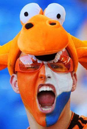 A Dutch fan cheers before the Euro 2008 Championships quarter-final football match the Netherlands vs. Russia on June 21, 2008 in the stands of St. Jakob-Park in Basel. AFP PHOTO / PIERRE-PHILIPPE MARCOU -- MOBILE SERVICES OUT --
