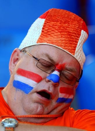 A Dutch fan rests before the Euro 2008 Championships quarter-final football match the Netherlands vs. Russia on June 21, 2008 in the stands of St. Jakob-Park in Basel. AFP PHOTO / PIERRE-PHILIPPE MARCOU -- MOBILE SERVICES OUT --