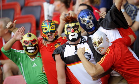 Germany and Spain fans wearing masks are pictured before the start of the Euro 2008 championships final football match Germany vs. Spain on June 29, 2008 at Ernst-Happel stadium in Vienna, Austria. AFP PHOTO / FRANCK FIFE -- MOBILE SERVICES OUT -- (Photo credit should read FRANCK FIFE/AFP/Getty Images)
