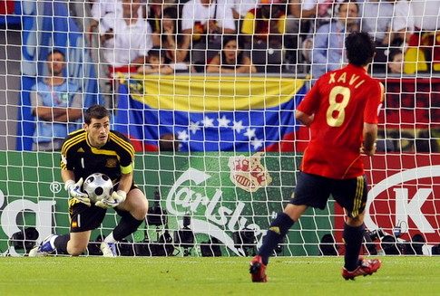 Spanish goalkeeper Iker Casillas (L) makes a save next to Spanish midfielder Xavi Hernandez during the Euro 2008 championships final football match Germany vs. Spain on June 29, 2008 at Ernst-Happel stadium in Vienna, Austria. AFP PHOTO / DAMIEN MEYER -- MOBILE SERVICES OUT -- (Photo credit should read DAMIEN MEYER/AFP/Getty Images)