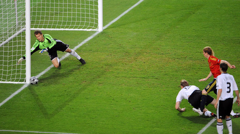 German goalkeeper Jens Lehmann (L) dives for the ball kicked by Spanish forward Fernando Torre (2R) in front of German defender Per Mertesacker (C) and German defender Arne Friedrich (R) during the Euro 2008 championships final football match Germany vs. Spain on June 29, 2008 at Ernst-Happel stadium in Vienna, Austria. AFP PHOTO / MLADEN ANTONOV -- MOBILE SERVICES OUT -- (Photo credit should read MLADEN ANTONOV/AFP/Getty Images)