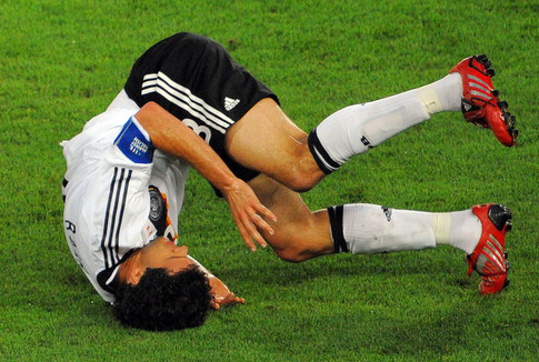 German midfielder Michael Ballack falls during the Euro 2008 championships final football match Germany vs. Spain on June 29, 2008 at Ernst-Happel stadium in Vienna, Austria. AFP PHOTO / VINCENZO PINTO -- MOBILE SERVICES OUT -- (Photo credit should read VINCENZO PINTO/AFP/Getty Images)
