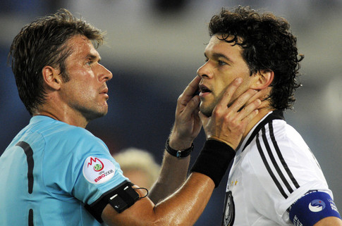 Italian referee Roberto Rosetti  (L) inspects the face of German midfielder Michael Ballack during the Euro 2008 championships final football match Germany vs. Spain on June 29, 2008 at Ernst-Happel stadium in Vienna, Austria.    AFP PHOTO DDP / TORSTEN SILZ           -- MOBILE SERVICES OUT -- (Photo credit should read TORSTEN SILZ/AFP/Getty Images)