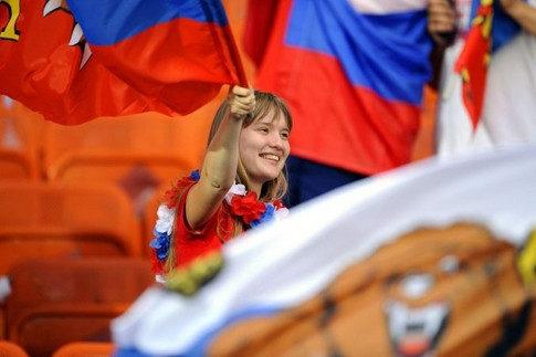 A Russia supporter waves a flag before the start of  the Euro 2008 championships semi-final football match Russia vs. Spain on June 26, 2008 at Ernst-Happel stadium in Vienna, Austria. AFP PHOTO / DAMIEN MEYER -- MOBILE SERVICES OUT --