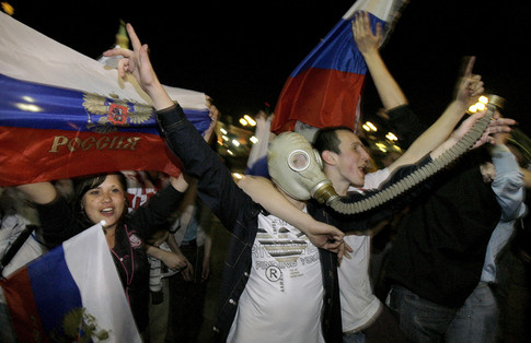 Russian football fans celebrate near Red Square after the Euro 2008 semi-final match between Russia and Spain in Moscow early June 27, 2008. Despite Spain's 3-0 win, it has been more than 20 years since Russia has had such a serious presence on the international footabll stage and many citizens are proud of their team's performance.                       AFP PHOTO / DIMA KOROTAYEV (Photo credit should read DIMA KOROTAYEV/AFP/Getty Images)