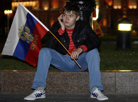A Russian football fan sits dejected after watching the Euro 2008 semi-final match between Russia and Spain near Red Square in Moscow early June 27, 2008. Spain won 3-0.               AFP PHOTO / ALEXEY SAZONOV (Photo credit should read Alexey SAZONOV/AFP/Getty Images)