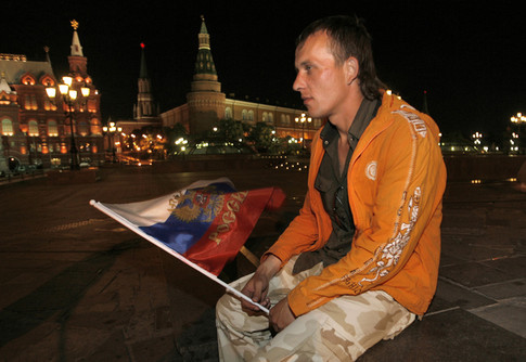 A Russian football fan sits dejected after watching the Euro 2008 semi-final match between Russia and Spain near Red Square in Moscow early on June 27, 2008. Spain won 3-0.                      AFP PHOTO / ALEXEY SAZONOV (Photo credit should read Alexey SAZONOV/AFP/Getty Images)