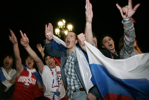 Russian football fans celebrate the success of the Russian national soccer team in Euro 2008 after watching the semi-final match between Russia Spain in Moscow early June 27, 2008. Spain won 3-0.  AFP PHOTO / NATALIA KOLESNIKOVA (Photo credit should read NATALIA KOLESNIKOVA/AFP/Getty Images)