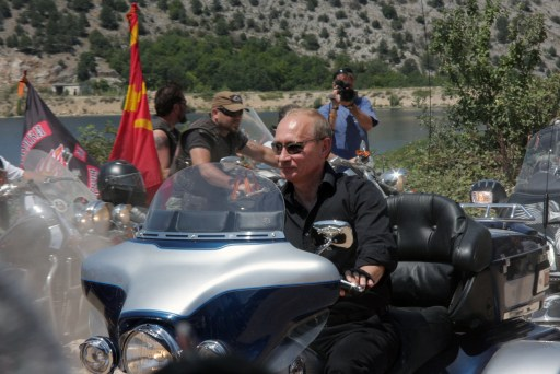 Russia's Prime Minister Vladimir Putin rides a Harley Davidson Lehman Trike as he visits Russian and Ukrainian motorbikers at their camp near Sevastopol in Ukraine's Crimea on July 24, 2010.       TOPSHOTS/AFP PHOTO/Vasiliy BATANOV