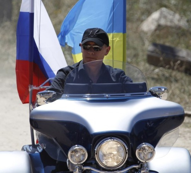 Russia's Prime Minister Vladimir Putin rides Harley Davidson Lehman Trike decorated with Russian and Ukrainian national flags as he arrives for the meeting with motorbikers at their camp near Sevastopol in Ukraine's Crimea on July 24, 2010.  REUTERS/Sergei Karpukhin