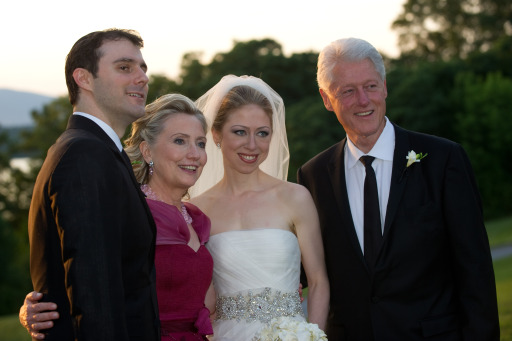 "Former US president Bill Clinton (R) and wife US Secretary of State Hillary Clinton (2nd-L) are pictured with Chelsea Clinton (2nd-R) during her marriage ceremony with Marc Mezvinsky (L) on July 31, 2010 in Rhinebeck, New Yotk.  Chelsea Clinton married her longtime boyfriend Marc Mezvinsky, ending weeks of secretive build-up about the former first daughter's wedding.  ""Today, we watched with great pride and overwhelming emotion as Chelsea and Marc wed in a beautiful ceremony at Astor Courts, surrounded by family and their close friends,"" ex-president Bill Clinton and Secretary of State Hillary Clinton said in a statement.   AFP PHOTO / photoshelter.com / Barbara KINNEY  == RESTRICTED TO EDITORIAL USE / NO SALES /  NO MARKETING / NO ADVERTISING =="