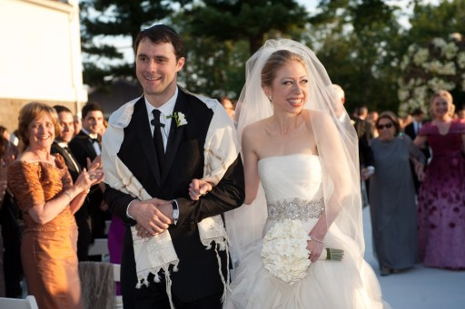 "Chelsea Clinton, daughter of former US president Bill Clinton, is pictured during her marriage ceremony with Marc Mezvinsky on July 31, 2010 in Rhinebeck, New Yotk.  Chelsea Clinton married her longtime boyfriend Marc Mezvinsky, ending weeks of secretive build-up about the former first daughter's wedding.  ""Today, we watched with great pride and overwhelming emotion as Chelsea and Marc wed in a beautiful ceremony at Astor Courts, surrounded by family and their close friends,"" ex-president Bill Clinton and Secretary of State Hillary Clinton said in a statement.   AFP PHOTO / photoshelter.com / Genevieve de Manio    == RESTRICTED TO EDITORIAL USE / NO SALES/  NO MARKETING / NO ADVERTIZING =="