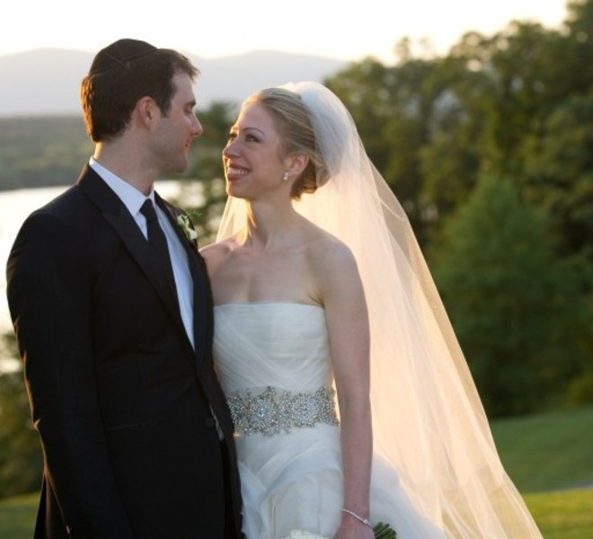 "Chelsea Clinton, daughter of former US president Bill Clinton, is pictured during her marriage ceremony with Marc Mezvinsky on July 31, 2010 in Rhinebeck, New Yotk.  Chelsea Clinton married her longtime boyfriend Marc Mezvinsky, ending weeks of secretive build-up about the former first daughter's wedding.  ""Today, we watched with great pride and overwhelming emotion as Chelsea and Marc wed in a beautiful ceremony at Astor Courts, surrounded by family and their close friends,"" ex-president Bill Clinton and Secretary of State Hillary Clinton said in a statement.   AFP PHOTO / photoshelter.com / Barbara KINNEY  == RESTRICTED TO EDITORIAL USE / NO SALES /  NO MARKETING / NO ADVERTISING =="