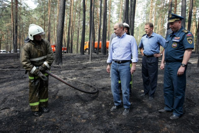 Russian Prime Minister Vladimir Putin (L) holds the hand of a small girl while meeting with people who lost their homes to fire during a visit to Voronezh on August 4, 2010. President Dmitry Medvedev interrupted his holiday to hold emergency talks on Russia's worst forest fires in modern history as firefighters struggled to contain the crisis. The area ablaze expanded by several thousand hectares in the past day as hundreds of new fires started in a disaster that has already claimed 48 lives, the emergencies ministry said.  AFP PHOTO / RIA NOVOSTI / POOL / ALEXEY NIKOLSKY , Russian Prime Minister Vladimir Putin (L) speaks with a man who lost his home to fire during a visit to Voronezh on August 4, 2010. President Dmitry Medvedev interrupted his holiday to hold emergency talks on Russia's worst forest fires in modern history as firefighters struggled to contain the crisis. The area ablaze expanded by several thousand hectares in the past day as hundreds of new fires started in a disaster that has already claimed 48 lives, the emergencies ministry said.  AFP PHOTO / RIA NOVOSTI / POOL / ALEXEY NIKOLSKY , Russian Prime Minister Vladimir Putin (C) walks to meet firefighters near the city of Voronezh on August 4, 2010. A heatwave has engulfed central parts of European Russia since mid June, pushing temperatures to the highest levels since records began and sparking forest fires that have killed at least 48 people.   AFP PHOTO / POOL / DENIS SINYAKOV , Russian Prime Minister Vladimir Putin (C) and Voronezh region Governor Alexei Gordeyev (L) are escorted by a local Rescue Minister officer at an airport in the city of Voronezh on August 4, 2010. Putin arrived to Voronezh to observe situation with wildefires in the region. A heatwave has engulfed central parts of European Russia since mid June, pushing temperatures to the highest levels since records began and sparking forest fires that have killed at least 48 people.   AFP PHOTO / POOL / DENIS SINYAKOV , Russian Prime Minister Vladimir Putin (L) meets with firefighters at the site of recent wildfires near the city of Voronezh on August 4, 2010.  A heatwave has engulfed central parts of European Russia since mid June, pushing temperatures to the highest levels since records began and sparking forest fires that have killed at least 48 people.   AFP PHOTO / POOL / DENIS SINYAKOV , Russian Prime Minister Vladimir Putin (C) listens to people displaced from their homes by wildfires, at their temporary living place in  the city of Voronezh on August 4, 2010.  A heatwave has engulfed central parts of European Russia since mid June, pushing temperatures to the highest levels since records began and sparking forest fires that have killed at least 48 people.   AFP PHOTO / POOL / DENIS SINYAKOV , Russian Prime Minister Vladimir Putin (C) listens to people displaced from their homes by wildfires, at their temporary living place in  the city of Voronezh on August 4, 2010.  A heatwave has engulfed central parts of European Russia since mid June, pushing temperatures to the highest levels since records began and sparking forest fires that have killed at least 48 people.   AFP PHOTO / POOL / DENIS SINYAKOV , Russian Prime Minister Vladimir Putin (C) looks at burnt trees in the forest areas near Voronezh on August 4, 2010. President Dmitry Medvedev interrupted his holiday to hold emergency talks on Russia's worst forest fires in modern history as firefighters struggled to contain the crisis. The area ablaze expanded by several thousand hectares in the past day as hundreds of new fires started in a disaster that has already claimed 48 lives, the emergencies ministry said.  AFP PHOTO / RIA NOVOSTI / POOL / ALEXEY NIKOLSKY , Russian Prime Minister Vladimir Putin (C) shakes hands with a firefighter while visiting the burnt out forest areas near Voronezh on August 4, 2010. President Dmitry Medvedev interrupted his holiday to hold emergency talks on Russia's worst forest fires in modern history as firefighters struggled to contain the crisis. The area ablaze expanded by several thousand hectares in the past day as hundreds of new fires started in a disaster that has already claimed 48 lives, the emergencies ministry said.  AFP PHOTO / RIA NOVOSTI / POOL / ALEXEY NIKOLSKY , Russian Prime Minister Vladimir Putin (C) speaks with firefighters while visiting the burnt out forest areas near Voronezh on August 4, 2010. President Dmitry Medvedev interrupted his holiday to hold emergency talks on Russia's worst forest fires in modern history as firefighters struggled to contain the crisis. The area ablaze expanded by several thousand hectares in the past day as hundreds of new fires started in a disaster that has already claimed 48 lives, the emergencies ministry said.  AFP PHOTO / RIA NOVOSTI / POOL / ALEXEY NIKOLSKY
