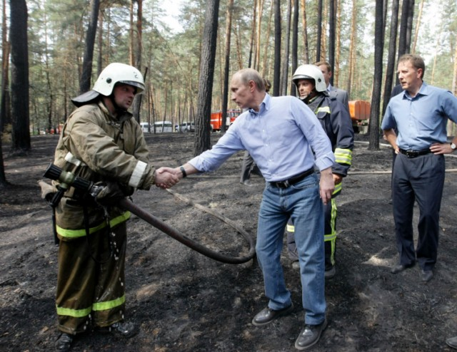 Russian Prime Minister Vladimir Putin (L) holds the hand of a small girl while meeting with people who lost their homes to fire during a visit to Voronezh on August 4, 2010. President Dmitry Medvedev interrupted his holiday to hold emergency talks on Russia's worst forest fires in modern history as firefighters struggled to contain the crisis. The area ablaze expanded by several thousand hectares in the past day as hundreds of new fires started in a disaster that has already claimed 48 lives, the emergencies ministry said.  AFP PHOTO / RIA NOVOSTI / POOL / ALEXEY NIKOLSKY , Russian Prime Minister Vladimir Putin (L) speaks with a man who lost his home to fire during a visit to Voronezh on August 4, 2010. President Dmitry Medvedev interrupted his holiday to hold emergency talks on Russia's worst forest fires in modern history as firefighters struggled to contain the crisis. The area ablaze expanded by several thousand hectares in the past day as hundreds of new fires started in a disaster that has already claimed 48 lives, the emergencies ministry said.  AFP PHOTO / RIA NOVOSTI / POOL / ALEXEY NIKOLSKY , Russian Prime Minister Vladimir Putin (C) walks to meet firefighters near the city of Voronezh on August 4, 2010. A heatwave has engulfed central parts of European Russia since mid June, pushing temperatures to the highest levels since records began and sparking forest fires that have killed at least 48 people.   AFP PHOTO / POOL / DENIS SINYAKOV , Russian Prime Minister Vladimir Putin (C) and Voronezh region Governor Alexei Gordeyev (L) are escorted by a local Rescue Minister officer at an airport in the city of Voronezh on August 4, 2010. Putin arrived to Voronezh to observe situation with wildefires in the region. A heatwave has engulfed central parts of European Russia since mid June, pushing temperatures to the highest levels since records began and sparking forest fires that have killed at least 48 people.   AFP PHOTO / POOL / DENIS SINYAKOV , Russian Prime Minister Vladimir Putin (L) meets with firefighters at the site of recent wildfires near the city of Voronezh on August 4, 2010.  A heatwave has engulfed central parts of European Russia since mid June, pushing temperatures to the highest levels since records began and sparking forest fires that have killed at least 48 people.   AFP PHOTO / POOL / DENIS SINYAKOV , Russian Prime Minister Vladimir Putin (C) listens to people displaced from their homes by wildfires, at their temporary living place in  the city of Voronezh on August 4, 2010.  A heatwave has engulfed central parts of European Russia since mid June, pushing temperatures to the highest levels since records began and sparking forest fires that have killed at least 48 people.   AFP PHOTO / POOL / DENIS SINYAKOV , Russian Prime Minister Vladimir Putin (C) listens to people displaced from their homes by wildfires, at their temporary living place in  the city of Voronezh on August 4, 2010.  A heatwave has engulfed central parts of European Russia since mid June, pushing temperatures to the highest levels since records began and sparking forest fires that have killed at least 48 people.   AFP PHOTO / POOL / DENIS SINYAKOV , Russian Prime Minister Vladimir Putin (C) looks at burnt trees in the forest areas near Voronezh on August 4, 2010. President Dmitry Medvedev interrupted his holiday to hold emergency talks on Russia's worst forest fires in modern history as firefighters struggled to contain the crisis. The area ablaze expanded by several thousand hectares in the past day as hundreds of new fires started in a disaster that has already claimed 48 lives, the emergencies ministry said.  AFP PHOTO / RIA NOVOSTI / POOL / ALEXEY NIKOLSKY , Russian Prime Minister Vladimir Putin (C) shakes hands with a firefighter while visiting the burnt out forest areas near Voronezh on August 4, 2010. President Dmitry Medvedev interrupted his holiday to hold emergency talks on Russia's worst forest fires in modern history as firefighters struggled to contain the crisis. The area ablaze expanded by several thousand hectares in the past day as hundreds of new fires started in a disaster that has already claimed 48 lives, the emergencies ministry said.  AFP PHOTO / RIA NOVOSTI / POOL / ALEXEY NIKOLSKY