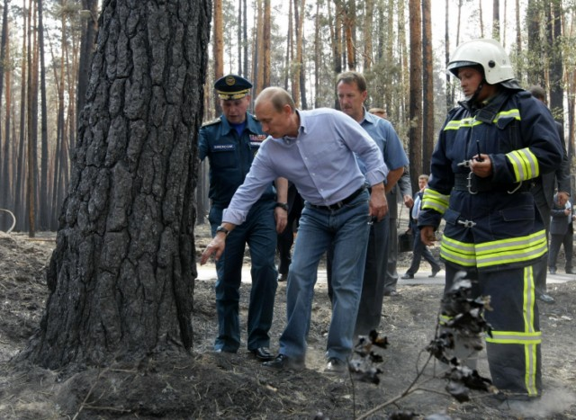 Russian Prime Minister Vladimir Putin (L) holds the hand of a small girl while meeting with people who lost their homes to fire during a visit to Voronezh on August 4, 2010. President Dmitry Medvedev interrupted his holiday to hold emergency talks on Russia's worst forest fires in modern history as firefighters struggled to contain the crisis. The area ablaze expanded by several thousand hectares in the past day as hundreds of new fires started in a disaster that has already claimed 48 lives, the emergencies ministry said.  AFP PHOTO / RIA NOVOSTI / POOL / ALEXEY NIKOLSKY , Russian Prime Minister Vladimir Putin (L) speaks with a man who lost his home to fire during a visit to Voronezh on August 4, 2010. President Dmitry Medvedev interrupted his holiday to hold emergency talks on Russia's worst forest fires in modern history as firefighters struggled to contain the crisis. The area ablaze expanded by several thousand hectares in the past day as hundreds of new fires started in a disaster that has already claimed 48 lives, the emergencies ministry said.  AFP PHOTO / RIA NOVOSTI / POOL / ALEXEY NIKOLSKY , Russian Prime Minister Vladimir Putin (C) walks to meet firefighters near the city of Voronezh on August 4, 2010. A heatwave has engulfed central parts of European Russia since mid June, pushing temperatures to the highest levels since records began and sparking forest fires that have killed at least 48 people.   AFP PHOTO / POOL / DENIS SINYAKOV , Russian Prime Minister Vladimir Putin (C) and Voronezh region Governor Alexei Gordeyev (L) are escorted by a local Rescue Minister officer at an airport in the city of Voronezh on August 4, 2010. Putin arrived to Voronezh to observe situation with wildefires in the region. A heatwave has engulfed central parts of European Russia since mid June, pushing temperatures to the highest levels since records began and sparking forest fires that have killed at least 48 people.   AFP PHOTO / POOL / DENIS SINYAKOV , Russian Prime Minister Vladimir Putin (L) meets with firefighters at the site of recent wildfires near the city of Voronezh on August 4, 2010.  A heatwave has engulfed central parts of European Russia since mid June, pushing temperatures to the highest levels since records began and sparking forest fires that have killed at least 48 people.   AFP PHOTO / POOL / DENIS SINYAKOV , Russian Prime Minister Vladimir Putin (C) listens to people displaced from their homes by wildfires, at their temporary living place in  the city of Voronezh on August 4, 2010.  A heatwave has engulfed central parts of European Russia since mid June, pushing temperatures to the highest levels since records began and sparking forest fires that have killed at least 48 people.   AFP PHOTO / POOL / DENIS SINYAKOV , Russian Prime Minister Vladimir Putin (C) listens to people displaced from their homes by wildfires, at their temporary living place in  the city of Voronezh on August 4, 2010.  A heatwave has engulfed central parts of European Russia since mid June, pushing temperatures to the highest levels since records began and sparking forest fires that have killed at least 48 people.   AFP PHOTO / POOL / DENIS SINYAKOV , Russian Prime Minister Vladimir Putin (C) looks at burnt trees in the forest areas near Voronezh on August 4, 2010. President Dmitry Medvedev interrupted his holiday to hold emergency talks on Russia's worst forest fires in modern history as firefighters struggled to contain the crisis. The area ablaze expanded by several thousand hectares in the past day as hundreds of new fires started in a disaster that has already claimed 48 lives, the emergencies ministry said.  AFP PHOTO / RIA NOVOSTI / POOL / ALEXEY NIKOLSKY