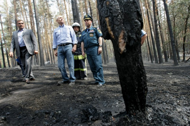 Russian Prime Minister Vladimir Putin (L) holds the hand of a small girl while meeting with people who lost their homes to fire during a visit to Voronezh on August 4, 2010. President Dmitry Medvedev interrupted his holiday to hold emergency talks on Russia's worst forest fires in modern history as firefighters struggled to contain the crisis. The area ablaze expanded by several thousand hectares in the past day as hundreds of new fires started in a disaster that has already claimed 48 lives, the emergencies ministry said.  AFP PHOTO / RIA NOVOSTI / POOL / ALEXEY NIKOLSKY , Russian Prime Minister Vladimir Putin (L) speaks with a man who lost his home to fire during a visit to Voronezh on August 4, 2010. President Dmitry Medvedev interrupted his holiday to hold emergency talks on Russia's worst forest fires in modern history as firefighters struggled to contain the crisis. The area ablaze expanded by several thousand hectares in the past day as hundreds of new fires started in a disaster that has already claimed 48 lives, the emergencies ministry said.  AFP PHOTO / RIA NOVOSTI / POOL / ALEXEY NIKOLSKY , Russian Prime Minister Vladimir Putin (C) walks to meet firefighters near the city of Voronezh on August 4, 2010. A heatwave has engulfed central parts of European Russia since mid June, pushing temperatures to the highest levels since records began and sparking forest fires that have killed at least 48 people.   AFP PHOTO / POOL / DENIS SINYAKOV , Russian Prime Minister Vladimir Putin (C) and Voronezh region Governor Alexei Gordeyev (L) are escorted by a local Rescue Minister officer at an airport in the city of Voronezh on August 4, 2010. Putin arrived to Voronezh to observe situation with wildefires in the region. A heatwave has engulfed central parts of European Russia since mid June, pushing temperatures to the highest levels since records began and sparking forest fires that have killed at least 48 people.   AFP PHOTO / POOL / DENIS SINYAKOV , Russian Prime Minister Vladimir Putin (L) meets with firefighters at the site of recent wildfires near the city of Voronezh on August 4, 2010.  A heatwave has engulfed central parts of European Russia since mid June, pushing temperatures to the highest levels since records began and sparking forest fires that have killed at least 48 people.   AFP PHOTO / POOL / DENIS SINYAKOV , Russian Prime Minister Vladimir Putin (C) listens to people displaced from their homes by wildfires, at their temporary living place in  the city of Voronezh on August 4, 2010.  A heatwave has engulfed central parts of European Russia since mid June, pushing temperatures to the highest levels since records began and sparking forest fires that have killed at least 48 people.   AFP PHOTO / POOL / DENIS SINYAKOV , Russian Prime Minister Vladimir Putin (C) listens to people displaced from their homes by wildfires, at their temporary living place in  the city of Voronezh on August 4, 2010.  A heatwave has engulfed central parts of European Russia since mid June, pushing temperatures to the highest levels since records began and sparking forest fires that have killed at least 48 people.   AFP PHOTO / POOL / DENIS SINYAKOV , Russian Prime Minister Vladimir Putin (C) looks at burnt trees in the forest areas near Voronezh on August 4, 2010. President Dmitry Medvedev interrupted his holiday to hold emergency talks on Russia's worst forest fires in modern history as firefighters struggled to contain the crisis. The area ablaze expanded by several thousand hectares in the past day as hundreds of new fires started in a disaster that has already claimed 48 lives, the emergencies ministry said.  AFP PHOTO / RIA NOVOSTI / POOL / ALEXEY NIKOLSKY , Russian Prime Minister Vladimir Putin (C) shakes hands with a firefighter while visiting the burnt out forest areas near Voronezh on August 4, 2010. President Dmitry Medvedev interrupted his holiday to hold emergency talks on Russia's worst forest fires in modern history as firefighters struggled to contain the crisis. The area ablaze expanded by several thousand hectares in the past day as hundreds of new fires started in a disaster that has already claimed 48 lives, the emergencies ministry said.  AFP PHOTO / RIA NOVOSTI / POOL / ALEXEY NIKOLSKY , Russian Prime Minister Vladimir Putin (C) speaks with firefighters while visiting the burnt out forest areas near Voronezh on August 4, 2010. President Dmitry Medvedev interrupted his holiday to hold emergency talks on Russia's worst forest fires in modern history as firefighters struggled to contain the crisis. The area ablaze expanded by several thousand hectares in the past day as hundreds of new fires started in a disaster that has already claimed 48 lives, the emergencies ministry said.  AFP PHOTO / RIA NOVOSTI / POOL / ALEXEY NIKOLSKY , Russian Prime Minister Vladimir Putin (2L) looks at trees while visiting the burnt out forest areas near Voronezh on August 4, 2010. President Dmitry Medvedev interrupted his holiday to hold emergency talks on Russia's worst forest fires in modern history as firefighters struggled to contain the crisis. The area ablaze expanded by several thousand hectares in the past day as hundreds of new fires started in a disaster that has already claimed 48 lives, the emergencies ministry said.  AFP PHOTO / RIA NOVOSTI / POOL / ALEXEY NIKOLSKY