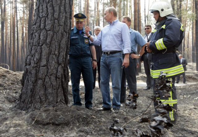 Russian Prime Minister Vladimir Putin (L) holds the hand of a small girl while meeting with people who lost their homes to fire during a visit to Voronezh on August 4, 2010. President Dmitry Medvedev interrupted his holiday to hold emergency talks on Russia's worst forest fires in modern history as firefighters struggled to contain the crisis. The area ablaze expanded by several thousand hectares in the past day as hundreds of new fires started in a disaster that has already claimed 48 lives, the emergencies ministry said.  AFP PHOTO / RIA NOVOSTI / POOL / ALEXEY NIKOLSKY , Russian Prime Minister Vladimir Putin (L) speaks with a man who lost his home to fire during a visit to Voronezh on August 4, 2010. President Dmitry Medvedev interrupted his holiday to hold emergency talks on Russia's worst forest fires in modern history as firefighters struggled to contain the crisis. The area ablaze expanded by several thousand hectares in the past day as hundreds of new fires started in a disaster that has already claimed 48 lives, the emergencies ministry said.  AFP PHOTO / RIA NOVOSTI / POOL / ALEXEY NIKOLSKY , Russian Prime Minister Vladimir Putin (C) walks to meet firefighters near the city of Voronezh on August 4, 2010. A heatwave has engulfed central parts of European Russia since mid June, pushing temperatures to the highest levels since records began and sparking forest fires that have killed at least 48 people.   AFP PHOTO / POOL / DENIS SINYAKOV , Russian Prime Minister Vladimir Putin (C) and Voronezh region Governor Alexei Gordeyev (L) are escorted by a local Rescue Minister officer at an airport in the city of Voronezh on August 4, 2010. Putin arrived to Voronezh to observe situation with wildefires in the region. A heatwave has engulfed central parts of European Russia since mid June, pushing temperatures to the highest levels since records began and sparking forest fires that have killed at least 48 people.   AFP PHOTO / POOL / DENIS SINYAKOV , Russian Prime Minister Vladimir Putin (L) meets with firefighters at the site of recent wildfires near the city of Voronezh on August 4, 2010.  A heatwave has engulfed central parts of European Russia since mid June, pushing temperatures to the highest levels since records began and sparking forest fires that have killed at least 48 people.   AFP PHOTO / POOL / DENIS SINYAKOV , Russian Prime Minister Vladimir Putin (C) listens to people displaced from their homes by wildfires, at their temporary living place in  the city of Voronezh on August 4, 2010.  A heatwave has engulfed central parts of European Russia since mid June, pushing temperatures to the highest levels since records began and sparking forest fires that have killed at least 48 people.   AFP PHOTO / POOL / DENIS SINYAKOV , Russian Prime Minister Vladimir Putin (C) listens to people displaced from their homes by wildfires, at their temporary living place in  the city of Voronezh on August 4, 2010.  A heatwave has engulfed central parts of European Russia since mid June, pushing temperatures to the highest levels since records began and sparking forest fires that have killed at least 48 people.   AFP PHOTO / POOL / DENIS SINYAKOV , Russian Prime Minister Vladimir Putin (C) looks at burnt trees in the forest areas near Voronezh on August 4, 2010. President Dmitry Medvedev interrupted his holiday to hold emergency talks on Russia's worst forest fires in modern history as firefighters struggled to contain the crisis. The area ablaze expanded by several thousand hectares in the past day as hundreds of new fires started in a disaster that has already claimed 48 lives, the emergencies ministry said.  AFP PHOTO / RIA NOVOSTI / POOL / ALEXEY NIKOLSKY , Russian Prime Minister Vladimir Putin (C) shakes hands with a firefighter while visiting the burnt out forest areas near Voronezh on August 4, 2010. President Dmitry Medvedev interrupted his holiday to hold emergency talks on Russia's worst forest fires in modern history as firefighters struggled to contain the crisis. The area ablaze expanded by several thousand hectares in the past day as hundreds of new fires started in a disaster that has already claimed 48 lives, the emergencies ministry said.  AFP PHOTO / RIA NOVOSTI / POOL / ALEXEY NIKOLSKY , Russian Prime Minister Vladimir Putin (C) speaks with firefighters while visiting the burnt out forest areas near Voronezh on August 4, 2010. President Dmitry Medvedev interrupted his holiday to hold emergency talks on Russia's worst forest fires in modern history as firefighters struggled to contain the crisis. The area ablaze expanded by several thousand hectares in the past day as hundreds of new fires started in a disaster that has already claimed 48 lives, the emergencies ministry said.  AFP PHOTO / RIA NOVOSTI / POOL / ALEXEY NIKOLSKY , Russian Prime Minister Vladimir Putin (2L) looks at trees while visiting the burnt out forest areas near Voronezh on August 4, 2010. President Dmitry Medvedev interrupted his holiday to hold emergency talks on Russia's worst forest fires in modern history as firefighters struggled to contain the crisis. The area ablaze expanded by several thousand hectares in the past day as hundreds of new fires started in a disaster that has already claimed 48 lives, the emergencies ministry said.  AFP PHOTO / RIA NOVOSTI / POOL / ALEXEY NIKOLSKY , Russian Prime Minister Vladimir Putin (C) looks at trees while visiting the burnt out forest areas near Voronezh on August 4, 2010. President Dmitry Medvedev interrupted his holiday to hold emergency talks on Russia's worst forest fires in modern history as firefighters struggled to contain the crisis. The area ablaze expanded by several thousand hectares in the past day as hundreds of new fires started in a disaster that has already claimed 48 lives, the emergencies ministry said.  AFP PHOTO / RIA NOVOSTI / POOL / ALEXEY NIKOLSKY
