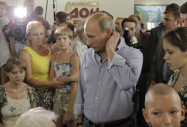 Russian Prime Minister Vladimir Putin (L) holds the hand of a small girl while meeting with people who lost their homes to fire during a visit to Voronezh on August 4, 2010. President Dmitry Medvedev interrupted his holiday to hold emergency talks on Russia's worst forest fires in modern history as firefighters struggled to contain the crisis. The area ablaze expanded by several thousand hectares in the past day as hundreds of new fires started in a disaster that has already claimed 48 lives, the emergencies ministry said.  AFP PHOTO / RIA NOVOSTI / POOL / ALEXEY NIKOLSKY , Russian Prime Minister Vladimir Putin (L) speaks with a man who lost his home to fire during a visit to Voronezh on August 4, 2010. President Dmitry Medvedev interrupted his holiday to hold emergency talks on Russia's worst forest fires in modern history as firefighters struggled to contain the crisis. The area ablaze expanded by several thousand hectares in the past day as hundreds of new fires started in a disaster that has already claimed 48 lives, the emergencies ministry said.  AFP PHOTO / RIA NOVOSTI / POOL / ALEXEY NIKOLSKY , Russian Prime Minister Vladimir Putin (C) walks to meet firefighters near the city of Voronezh on August 4, 2010. A heatwave has engulfed central parts of European Russia since mid June, pushing temperatures to the highest levels since records began and sparking forest fires that have killed at least 48 people.   AFP PHOTO / POOL / DENIS SINYAKOV , Russian Prime Minister Vladimir Putin (C) and Voronezh region Governor Alexei Gordeyev (L) are escorted by a local Rescue Minister officer at an airport in the city of Voronezh on August 4, 2010. Putin arrived to Voronezh to observe situation with wildefires in the region. A heatwave has engulfed central parts of European Russia since mid June, pushing temperatures to the highest levels since records began and sparking forest fires that have killed at least 48 people.   AFP PHOTO / POOL / DENIS SINYAKOV , Russian Prime Minister Vladimir Putin (L) meets with firefighters at the site of recent wildfires near the city of Voronezh on August 4, 2010.  A heatwave has engulfed central parts of European Russia since mid June, pushing temperatures to the highest levels since records began and sparking forest fires that have killed at least 48 people.   AFP PHOTO / POOL / DENIS SINYAKOV , Russian Prime Minister Vladimir Putin (C) listens to people displaced from their homes by wildfires, at their temporary living place in  the city of Voronezh on August 4, 2010.  A heatwave has engulfed central parts of European Russia since mid June, pushing temperatures to the highest levels since records began and sparking forest fires that have killed at least 48 people.   AFP PHOTO / POOL / DENIS SINYAKOV
