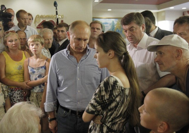 Russian Prime Minister Vladimir Putin (L) holds the hand of a small girl while meeting with people who lost their homes to fire during a visit to Voronezh on August 4, 2010. President Dmitry Medvedev interrupted his holiday to hold emergency talks on Russia's worst forest fires in modern history as firefighters struggled to contain the crisis. The area ablaze expanded by several thousand hectares in the past day as hundreds of new fires started in a disaster that has already claimed 48 lives, the emergencies ministry said.  AFP PHOTO / RIA NOVOSTI / POOL / ALEXEY NIKOLSKY , Russian Prime Minister Vladimir Putin (L) speaks with a man who lost his home to fire during a visit to Voronezh on August 4, 2010. President Dmitry Medvedev interrupted his holiday to hold emergency talks on Russia's worst forest fires in modern history as firefighters struggled to contain the crisis. The area ablaze expanded by several thousand hectares in the past day as hundreds of new fires started in a disaster that has already claimed 48 lives, the emergencies ministry said.  AFP PHOTO / RIA NOVOSTI / POOL / ALEXEY NIKOLSKY , Russian Prime Minister Vladimir Putin (C) walks to meet firefighters near the city of Voronezh on August 4, 2010. A heatwave has engulfed central parts of European Russia since mid June, pushing temperatures to the highest levels since records began and sparking forest fires that have killed at least 48 people.   AFP PHOTO / POOL / DENIS SINYAKOV , Russian Prime Minister Vladimir Putin (C) and Voronezh region Governor Alexei Gordeyev (L) are escorted by a local Rescue Minister officer at an airport in the city of Voronezh on August 4, 2010. Putin arrived to Voronezh to observe situation with wildefires in the region. A heatwave has engulfed central parts of European Russia since mid June, pushing temperatures to the highest levels since records began and sparking forest fires that have killed at least 48 people.   AFP PHOTO / POOL / DENIS SINYAKOV , Russian Prime Minister Vladimir Putin (L) meets with firefighters at the site of recent wildfires near the city of Voronezh on August 4, 2010.  A heatwave has engulfed central parts of European Russia since mid June, pushing temperatures to the highest levels since records began and sparking forest fires that have killed at least 48 people.   AFP PHOTO / POOL / DENIS SINYAKOV , Russian Prime Minister Vladimir Putin (C) listens to people displaced from their homes by wildfires, at their temporary living place in  the city of Voronezh on August 4, 2010.  A heatwave has engulfed central parts of European Russia since mid June, pushing temperatures to the highest levels since records began and sparking forest fires that have killed at least 48 people.   AFP PHOTO / POOL / DENIS SINYAKOV , Russian Prime Minister Vladimir Putin (C) listens to people displaced from their homes by wildfires, at their temporary living place in  the city of Voronezh on August 4, 2010.  A heatwave has engulfed central parts of European Russia since mid June, pushing temperatures to the highest levels since records began and sparking forest fires that have killed at least 48 people.   AFP PHOTO / POOL / DENIS SINYAKOV