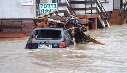 A car submerged in flood waters in the south-western Polish town of Bogatynia inundated after the Miedzianka River burst it's banks, a result of heavy rains on August 7, 2010.  AFP PHOTO/ PAP/GRZEGORZ HAWALEJ