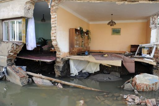 Photo taken on August 8, 2010 shows a flooded house in Hermanice village, near the Liberec city, North Bohemia. Eight people died and thousands were evacuated amid disrupted traffic and power outages as floods hit parts of central Europe following heavy rainfall on August 7, 2010, rescuers said. AFP PHOTO/ MICHAL CIZEK
