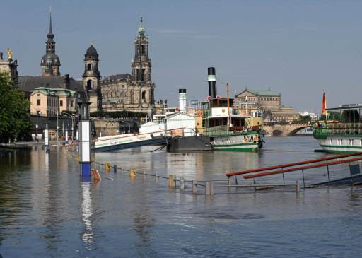 Excursion steam boats lay at the pier flooded by the Elbe river in Dresden, eastern Germany, on August 8, 2010. Heavy rains and a dam-break on Witka Lake in Poland near the German border led the Neisse and several other rivers in Germany, Poland and the Czech Republic to burst their banks.     AFP PHOTO     MATTHIAS HIEKEL    GERMANY OUT