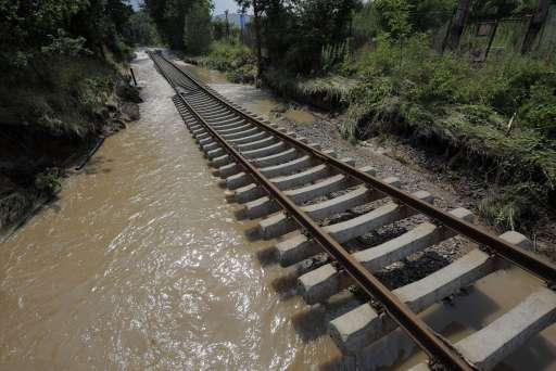 A section of a railway track is washed away by the floods of the Neisse river in Hagenwerder near Goerlitz, eastern Germany, on August 8, 2010. Heavy rains and a dam-break on Witka Lake in Poland near the German border led the Neisse and several other rivers in Germany, Poland and the Czech Republic to burst their banks.     AFP PHOTO     ROBERT MICHAEL