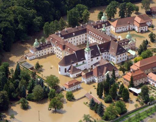 Aerial view shows the St. Marienthal monastery in Ostritz, eastern Germany, being surrounded by the floods of the Neisse river on August 8, 2010. Heavy rains and a dam-break on Witka Lake in Poland near the German border led the Neisse and several other rivers in Germany, Poland and the Czech Republic to burst their banks.     AFP PHOTO   MATTHIAS HIEKEL    GERMANY OUT
