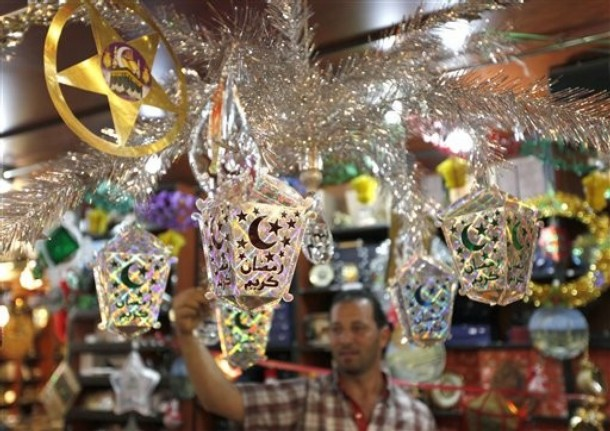 A Lebanese Muslim man, shops for decorations in preparation for the upcoming  Islamic holy month of Ramadan, in Beirut, Lebanon, Monday Aug. 9, 2010. Muslims traditionally decorate their homes, shops and streets for the holy month of Ramadan. Muslims throughout the world will be celebrating the holy fasting month of Ramadan, the holiest month in the Islamic calendar, refraining from eating, drinking, smoking and sex from sunrise to sunset. (AP Photo/Hussein Malla)