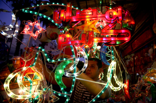 A Palestinian man arranges neon lights and other decorations for the upcoming Muslim holy month of Ramadan at his store in the northern city of Jenin, in the West Bank, on August 8, 2010. The start of Ramadan, the ninth and holiest month in the Muslim calendar, is traditionally determined by the sighting of a new moon. AFP PHOTO/SAIF DAHLAH
