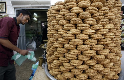 A worker dispalys cookies at a bakery ahead of Islam's holy fasting month of Ramadan on August 10, 2010. Depending on the sighting of the new moon, Muslims around the world will start ramadan around August 11, when they refrain from eating, drinking and having sex from dawn to dusk. AFP PHOTO/SABAH ARAR