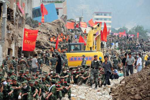 Hundreds of Chinese military personnel help with rescue and cleanup operations amid the rubble of landslide devastation in Zhouqu on August 11, 2010 in northwest China's Gansu province. Hopes of finding survivors of China's worst mudslides in decades is fading  as the death toll topped 700, with more than 1,000 people still missing under an avalanche of rock and sludge. More than 10,000 soldiers and rescuers combed through the mountains of mud that buried a remote area of the northwest province of Gansu at the weekend, but 72 hours after the disaster, the window of survival was quickly closing.  TOPSHOTS  AFP PHOTO/Frederic J. BROWN