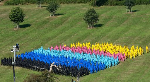 Members of the public take part in a naked installation for American artist Spencer Tunick (left in tower) at the Big Chill festival near Ledbury in Herefordshire on August 8, 2010. Those involved were painted in body paints and shot from above to create patterns and designs for the Tunick's photographs. Running from the 5th to the 8th of August, the festival features some of the more popular bands and musicians from the underground music scene as well more established acts such as Lily Allen and Massive Attack. AFP PHOTO/Leon Neal
