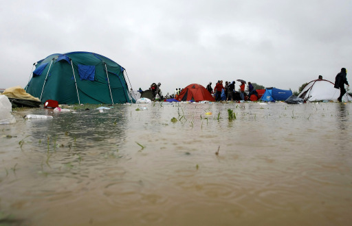 This picture taekn on August 16, 2010 shows flooded camping site at the festival Feest in het Park, after heavy rainfall, in Oudenaarde. Some 2000 people were evacuated from the site as the camping field was completely flooded following serious rainfall overnight.   AFP PHOTO/ BELGA PHOTO / PETER DECONINCK