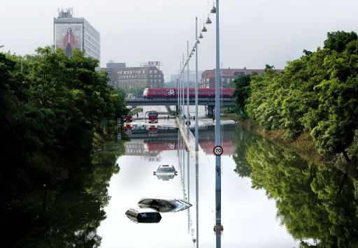 Cars are flodded at the beginning of a highway exit in Copenhagen on August 15, 2010 where several cars still are trapped in the water masses after the heavy rain in the area og Copenhagen and North Sealand last night.  AFP PHOTO/ Bax Lindhardt/Scanpix