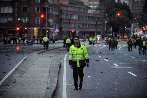A Colombian police officer stands at the site of an explosion in Bogota on August 12, 2010. A powerful explosion rocked northern Bogota early Thursday, causing extensive damage to a private radio station and shattering windows of buildings in the area, witnesses said. Police were investigating the possibility the explosion was caused by a car bomb, Bogota police commander Cesar Pinzon told Radio Caracol, which was hit by the blast. There were no immediate reports of casualties. AFP PHOTO/Eitan Abramovich