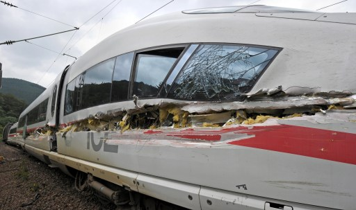 A damaged high-speed ICE train can be seen after it crashed with a dustbin truck near Lambrecht, western Germany, on August 17, 2010. Nine people were injured, two of them seriously. AFP PHOTO / RONALD WITTEK   GERMANY OUT