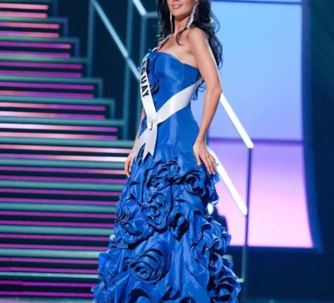 Miss Paraguay 2010 Yohana Benitez Olmedo is dressed in a gown during a preliminary event of the 2010 Miss Universe Competition in Las Vegas, Nevada on Thursday, August 19, 2010. The Miss Universe 2010 competition will air live on the NBC Television Network at 9 PM ET, August 23, 2010.     AFP PHOTO / Miss Universe Organization LP, LLLP   == RESTRICTED TO EDITORIAL USE / NO SALES / NO MARKETING / NO ADVERTISING ==