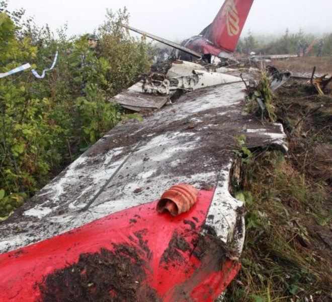 The wreckage of the Henan Airlines ERJ-190 jet made by Brazilian company Embraer which was carrying 96 people lies across the ground after it slammed into the ground on landing in the northeast city of Yichun in remote Heilongjiang province on August 25, 2010.  A Chinese airliner smashed into two pieces while trying to land in heavy fog, leaving at least 42 people dead but 54 survivors in the country's first major air disaster in nearly six years.          CHINA OUT    AFP PHOTO