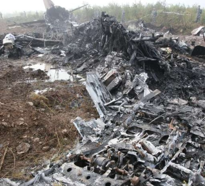 The wreckage of the Henan Airlines ERJ-190 jet made by Brazilian company Embraer which was carrying 96 people is spread across the ground after it slammed into the ground on landing in the northeast city of Yichun in remote Heilongjiang province on August 25, 2010.  The Chinese airliner smashed into two pieces while trying to land in heavy fog, leaving at least 42 people dead but 54 survivors in the country's first major air disaster in nearly six years.          CHINA OUT    AFP PHOTO