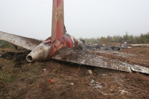 The wreckage of the Henan Airlines ERJ-190 jet tail-end, made by Brazilian company Embraer, lies in the northeast city of Yichun in remote Heilongjiang province on August 25, 2010.  A Chinese airliner smashed into two pieces while trying to land in heavy fog, leaving at least 42 people dead but 54 survivors in the country's first major air disaster in nearly six years.          CHINA OUT    AFP PHOTO
