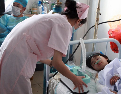 A young Chinese child who survived the Henan Airlines ERJ-190 jet crash gets medical treatment at a hospital in the northeast city of Yichun in Heilongjiang province on August 25, 2010.  A Chinese airliner smashed into two pieces while trying to land in heavy fog, leaving at least 42 people dead but 54 survivors in the country's first major air disaster in nearly six years.          CHINA OUT    AFP PHOTO