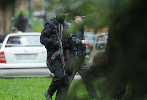 A police commando takes position on August 30, 2010 in the Bratislava suburb of Devinska Nova Ves, where a man armed with a shotgun opened fire in a street, killing six people and injuring 19, according to emergency services. The SME daily said on its website that the shooter was a 15-year-old drug addict, who shot himself dead after the rampage in Devinska Nova Ves. AFP PHOTO / SAMUEL KUBANI