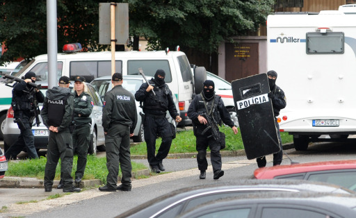 A police commando leaves the position on August 30, 2010 in the Bratislava suburb of Devinska Nova Ves, where a man armed with a shotgun opened fire in a street, killing six people and injuring 19, according to emergency services. The SME daily said on its website that the shooter was a 15-year-old drug addict, who shot himself dead after the rampage in Devinska Nova Ves. AFP PHOTO / SAMUEL KUBANI