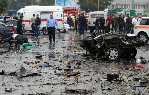 ATTENTION EDITORS: ALTERNATIVE CROP:  Russian investigators examine the site of a blast near a market in Vladikavkaz on September 9, 2010. At least 15 people were killed on and dozens wounded in an apparent suicide bombing outside a crowded central market in the Russian Caucasus city of Vladikavkaz, officials said. AFP PHOTO / STR