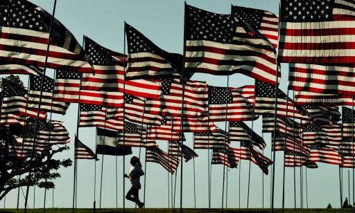"A woman jogs amongst flags erected by students and staff from Pepperdine University in Malibu, who placed nearly 3000 flags in the ground to honor the victims of the September 11, 2001 terrorist attacks in New York, on September 10, 2010.   An impassioned President Barack Obama warned Americans must not turn on one another over religion, after rows over Islam sparked global fury, nine years after the September 11 attacks. Obama also mounted a strident defense of American Muslims, paid tribute to believers fighting in the US armed forces, and said US citizens must remember who their true enemies were -- naming Al-Qaeda and ""terrorists."" The President has vowed a ""new beginning"" with Islam, but international tensions have spiked over a plan for a Muslim cultural center near the felled World Trade Center site in New York and a US pastor's threat to burn Korans.           AFP PHOTO/Mark RALSTON"