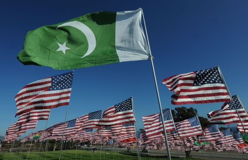 "The flag of Pakistan representing a 9/11 victim from that country, flies amongst American flags erected by students and staff from Pepperdine University in Malibu, who placed nearly 3000 flags in the ground to honor the victims of the September 11, 2001 terrorist attacks in New York, on September 10, 2010.   An impassioned President Barack Obama warned Americans must not turn on one another over religion, after rows over Islam sparked global fury, nine years after the September 11 attacks. Obama also mounted a strident defense of American Muslims, paid tribute to believers fighting in the US armed forces, and said US citizens must remember who their true enemies were -- naming Al-Qaeda and ""terrorists."" The President has vowed a ""new beginning"" with Islam, but international tensions have spiked over a plan for a Muslim cultural center near the felled World Trade Center site in New York and a US pastor's threat to burn Korans.           AFP PHOTO/Mark RALSTON"