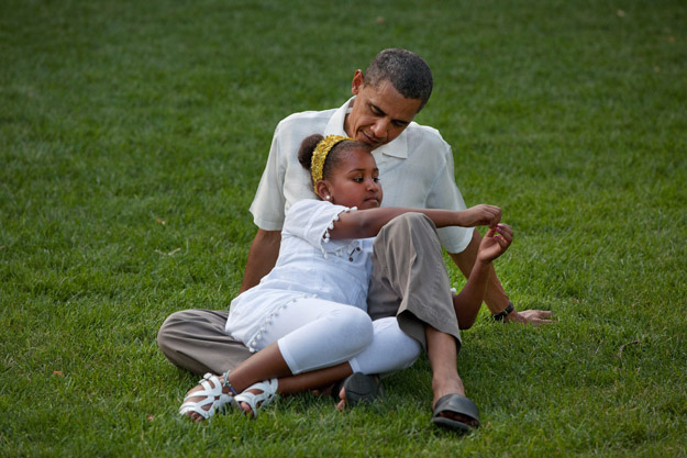 President Barack Obama sits with daughter Sasha during a barbecue with family and friends in celebration of his 49th birthday on the South Lawn of the White House, Aug. 8, 2010. (Official White House Photo by Pete Souza)